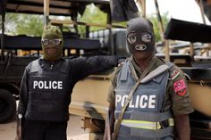 Nigerian police in Borno state pose before a patrol in Maiduguri on June 5, 2013/AFP