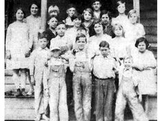 Students at the Ebenezer School in 1925. From left to right, front row, are: Carl Grovenstein, Ralph Zeigler, Cecil Owens and Walter Fail; second row: William Waldhour, David Wertz Seckinger, David Seckinger, Essie Grovenstein, Margaret Waldhour and Lois Hinely; third row: Willard Waldhour, Katie Mae Green, Freida Waldhour, Anna Zeigler and Ruth Fail, fourth row: Carmon Lynch, Miss Susie Kieffer (Teacher), Francis Green, Walter Green, Claude Owens and Mary Frances Seckinger.