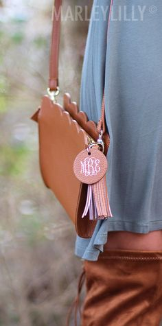 This Monogrammed Scalloped Crossbody is the perfect accessory for any outfit! Shop now at Marleylilly.com.