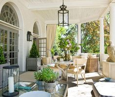 back porch refresh: replace recessed lighting with outdoor lanterns, wire the wall between windows for lantern sconces, paint hardyplank and window/door casings, frame out porch columns, add beadboard and molding to the ceiling