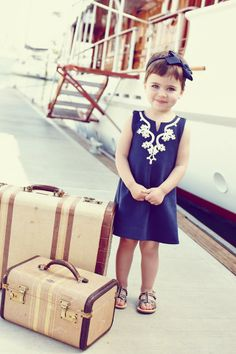 Little traveler ready to go. Sweet dress from Janie and Jack. Vintage suitcases. #kidstravel #kidsfashion #kidsstyle
