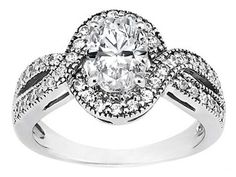 Oval Diamond Intertwined Halo Engagement Ring 0.30 tcw. In 14K White Gold