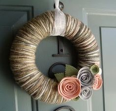 yarn wreath. I'm gonna get supplies to try this out this weekend. I need something pretty for my front door.