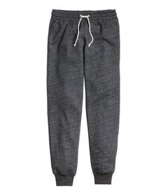 Sweatpants with elasticized drawstring waistband, side pockets, and ribbed hems.