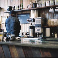 Atmospheric coffee shop with rustic wood bar via Last Night Stales.
