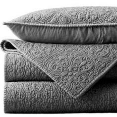 Textured grey bedding I want it.........love the grey. I like that it's not a super thick comforter because we would just be puting it over a down comforter.