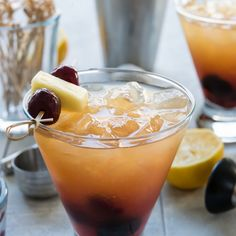 Wicked Waikiki Sour Cocktail Recipe Beverages with cherries, simple syrup, bourbon whiskey, amaretto, fresh lemon juice, pineapple juice, cherries, fresh pineapple