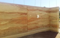 Rammed earth wall with pigments to show off the layers #rammedearth