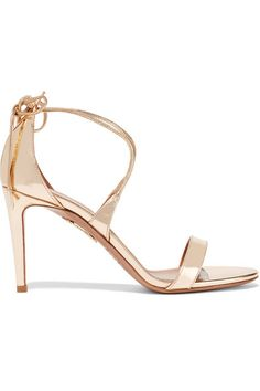 EXCLUSIVE AT NET-A-PORTER.COM. Aquazzura's elegant 'Linda' sandals are expertly crafted from high-shine mirrored-leather. Updated with a slightly shorter stiletto heel than the original style, this flattering pair ties at the ankle for customized support. The gold shade is endlessly versatile - team yours with a colorful party dress.