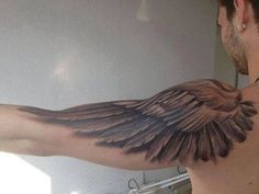 31 Wing tattoo on shoulder