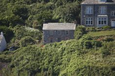 """Port Isaac - Doc Martin's fictional house - This is the house that is used quite often in the ITV series """"Doc Martin"""". This building is used as the home and surgery of the Doctor. In the real world it is known as the Fern Cottage. 