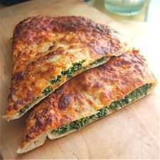 Spinach-Ricotta Calzone – a tasty thin pizza crust completely enfolds savory spinach/cheese filling.