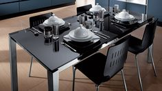 Scenery table by Scavolini. The Scenery table has frame and legs in chrome-plated or Grey, matt Black or gloss White varnished metal; the top is available extensible or fixed, in various colours of laminate, or fixed in various materials; the tops are available for viewing at first hand in the sample box) or extensible (with semi-automatic opening mechanism) tempered screen-printed glass, thickness 10 mm, gloss or mat, available in various colours. #Scavolini #Tables #Chairs #Stools