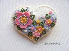 white flowery heart pin
