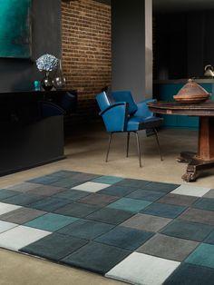 Der moderne Teppich Eden Pixel von benuta ist in viele einzelne Quadrate unterteilt, die farblich gut zusammenpassen. Er ist pflegeleicht und robust.