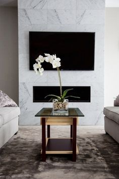 This modern coffee table stands out with clean lines and a two tone design. It's the perfect size for even small spaces.