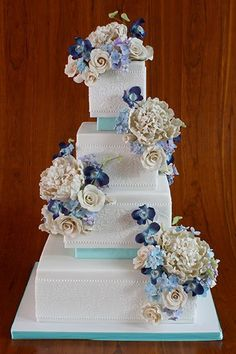 Add some height by separating tiers with bands of color.Cake by Elegantly Iced (=)