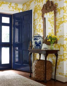 LOVE this wallpaper!! Perfect for a foyer! Also like the perfectly accessorized small table and Love the high gloss blue front door!