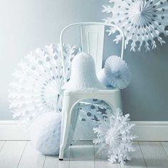 large snowflakes and bells made of white paper