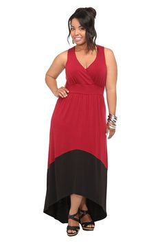 Sizes L to 5x Red And Black Color Block Hi-Lo Dress  Red and black color blocking defines a soft knit hi-lo dress with a banded waist and a back keyhole cutout. The stylish surplice neckline pays homage to the chic 70s wrap silhouette.