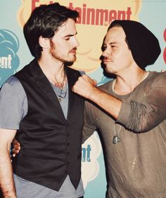 Photo of Colin O'Donoghue and Michael Raymond-James at Comic Con for fans of Colin O'Donoghue.