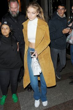 Who: Gigi Hadid What: A Perfect Fall Coat Why: Denim, a white shirt and a buttery suede, tan trench add up to a pulled-together look that will take you many fall miles. Get the look now: Billy Reid coat, $2,995, billyreid.com.    - HarpersBAZAAR.com