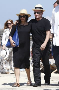 Bono and wife Ali Hewson in St Tropez #casualchic #blackonthebeach