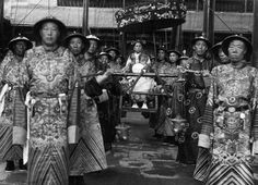 The Empress Cixi sits in a sedan chair, surrounded by eunuchs, circa 1903-04. Rumor has it that Cixi bribed the eunuchs to get better access to the emperor. Out of dozens of concubines, Cixi was the only one to bear a child.
