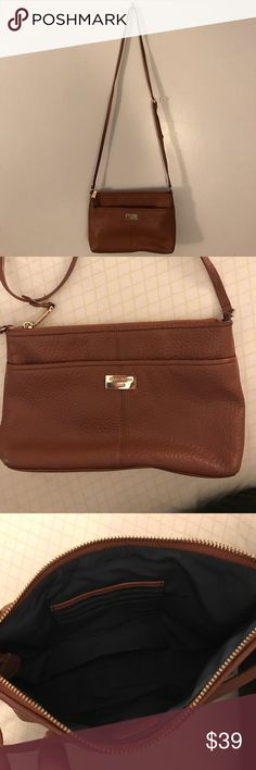 Cole Haan Crossbody  Cut everyday crossbody by Cole Haan. Front pocket with gold plated Cole Haan logo. Roomy interior with 4 slots for credit cards and ID. Additional leather logo tag in interior as well as logo zip handle. Cole Haan Bags Crossbody Bags