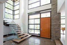 11. Floating Staircase Modern Home Aiming at Converting Traditionalists by David Small Design