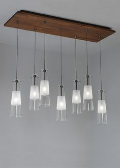 7-light rectangular metal canopy accented with solid wood or metal detail (also available in LED).