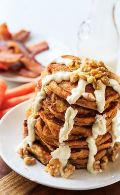 Carrot Cake Pancakes with Cream Cheese Glaze and toasted walnuts make a decadent Spring breakfast. They'd be perfect for an Easter brunch. If you're a fan of carrot cake, these orange-hued pancakes have your name written all over them.