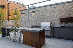 outside bar/kitchen - bespoke joinery concrete, corten steel details