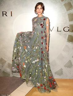 Oversized is not overrated: Although the billowing Valentino gown swamped Alexa's frame, she made the most of the extra fabric as she posed on arrival to the Italian luxury goods brand's Fifth Avenue flagship store