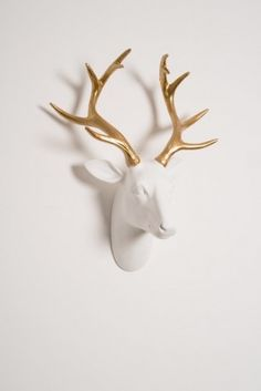 Deer head white reindeer wall decoration with cool gold horns, quirky retro ornament that's our best seller at Christmas, the ideal gift for that special lady,