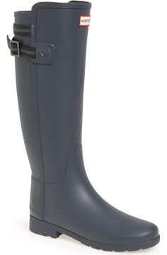 Staying stylish, sophisticated and puddle-proof with these cute Hunter rain boots in dark slate. An adjustable striped strap in the back adds a touch of nautical interest.