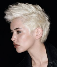 A short blonde straight coloured white spikey hairstyle by Jean Louis David