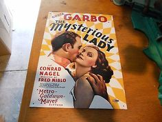 Greta-Garbo-The-Mysterious-Lady-Tin-Movie-Poster-Reproduction