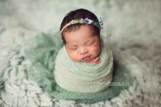 A twine tieback with mint coloured moss, preserved blue grasses, a silk flower and a pearl. Silk chiffon ties.Newborn sizeImages by,Newborn Photography By JadeJillian Greenhill PhotographyJennifer Rittenberry Photography