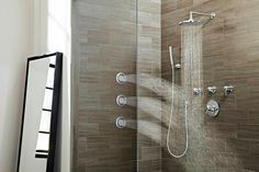 "Water wall: Tilting Mosaic ""body spray"" tiles come round or square and are designed for easy installation. They're also angling to be the first flush-mount spray tile that toggles from SPRAY to PULSE. From @moen"