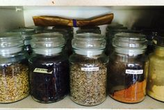 My many Douwe Egberts jars used as herb and spice pots!