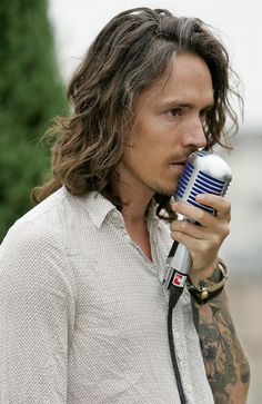 Brandon Boyd. Got gray hair and still looking fly.