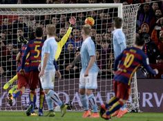 Barcelona's Argentinian forward Lionel Messi (R) scores a goal after shooting a free kick during the Spanish league football match FC Barcelona vs RC Celta de Vigo at the Camp Nou stadium in Barcelona on February 14, 2016