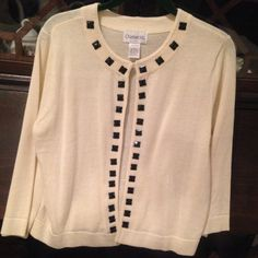 Cream color Sweater! NWOT  Cream color black pyramid button trim has hook & eye closure. 3/4 length sleeve NWOT! Light weight cotton never worn and comfortable! Sweaters
