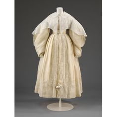 This dress has imbicile sleeves. This British dress was made of muslin and lined with silk. The sleeves are full from the shoulder to the wrist. Some sleeves would gather into a cuff at the wrist. This type of sleeve on a dress allowed people to think of it as a strait jacket from that time period.