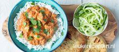 Malse stukjes kip gemarineerd in yoghurt en cashewnoten in een milde Indiase curry saus