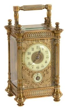 A Lacquered Brass Carriage Timepiece With Alarm,