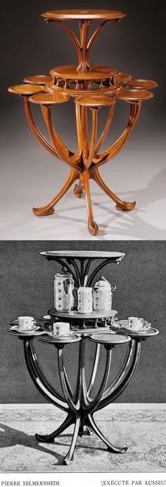 TONY SELMERSHEIM Art Nouveau Dumbwaiter, important and rare stand in walnut with several circular tops. Circa 1900. H : 43 1/3 Diam : 31 ½ in.