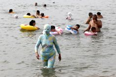A swimmer wore a full-body suit in Qingdao, China, Sunday.