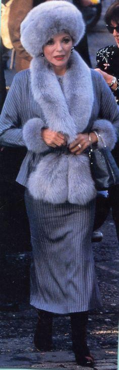 Joan Collins wearing fur coat in 1990s.
